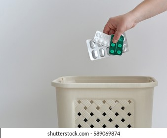hand throwing pills away. Health concept