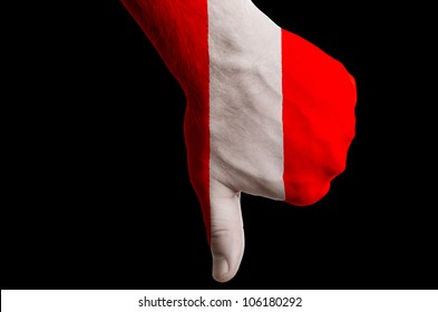 Hand with thumb down gesture in colored peru national flag as symbol of negative political, cultural, social management of country