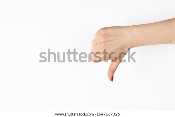 Hand thumb down isolated on the left side on white background. Rejection symbol