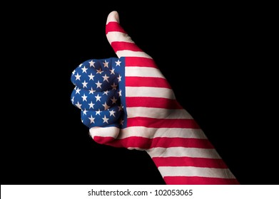 Hand with thumb up gesture in colored america national flag as symbol of excellence, achievement, good, - for tourism and touristic advertising, positive political, social management of country
