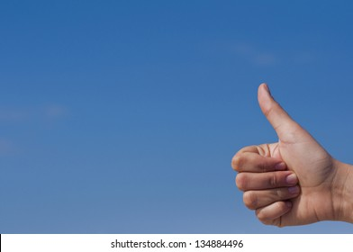 Hand With Thumb Up On Blue Sky Background
