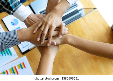 Hand together concept, businessman and his group hold hand  business man woman on the table show their working about analysis marketing have graph chart on the table