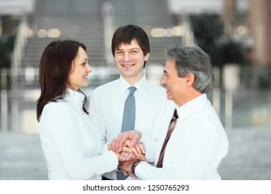 Hand together group office teamwork show power of success