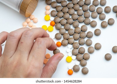 Woman's hand took medicine from the bulk of the drug. White background
