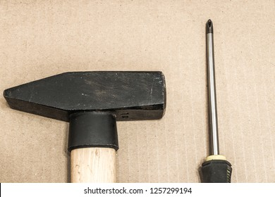 Hand tools: hammer and screwdriver.