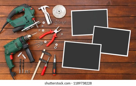 Hand Tools on the Wood Table with Empty Photo Frames