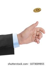 Hand tossing a bitcoin isolated on white background