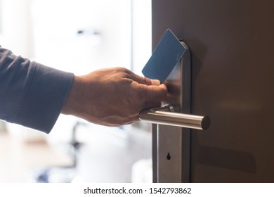 hand touch keycard on hotel door