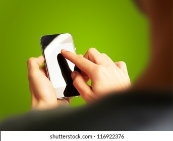 Hand Touch Mobile On Green Background