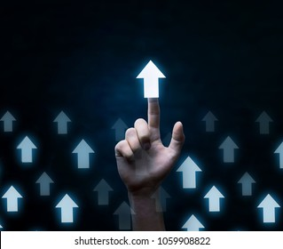 Hand touching arrows. Business growth and success concept.