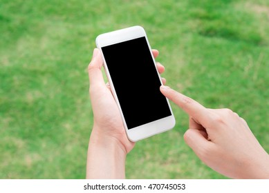 Hand touching blank screen mobile smart phone outdoor.