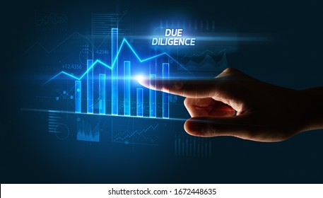 Hand touching DUE DILIGENCE button, business concept