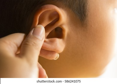 Hand touching ear of child or ear of boy.Concept and idea for health.Close  up