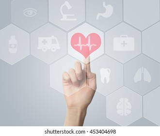 Hand touching E-Health symbol connected to health