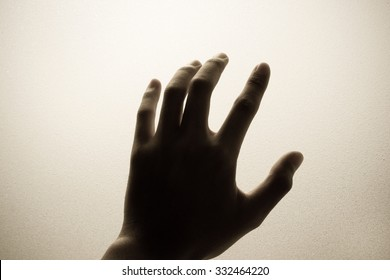 hand touching frosted glass