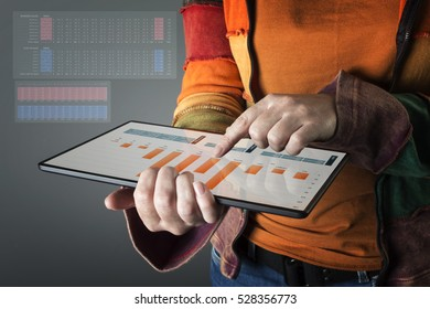 Hand touching modern tablet with financial graph. Business analysis concept