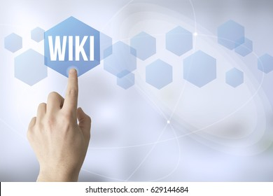 hand touching a touch screen interface with wiki