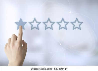 hand touching a touch screen interface with one star rating