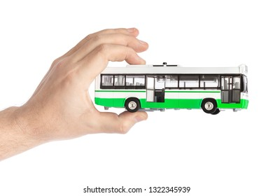 Hand with toy bus isolated on white background