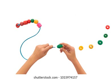 hand with toy show that playing activity promote development, thinking, fine hand using skill, coordination and visual perception