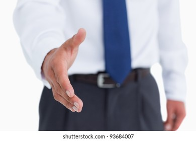 Hand of tradesman ready to be shaken against a white background