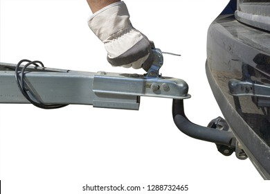 Hand and trailer coupling with trailer at a car, isolated