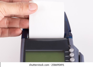 Hand With Transaction Paper on Credit Card Machine