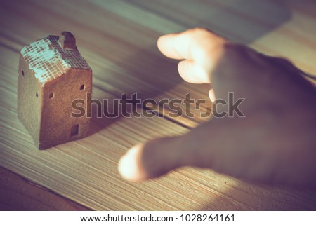 Hand Try Grab Brown Ceramic House Stock Photo (Edit Now