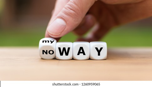 "Hand is turning a dice and changes the expression ""no way"" to ""my way"""