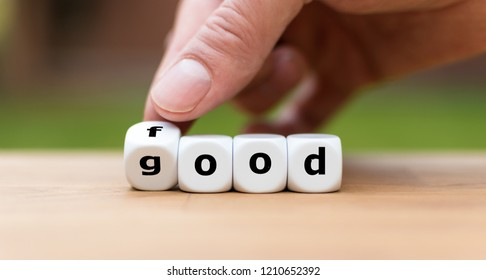 Hand is turning a dice and changes the word good to food