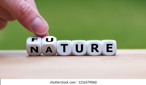 Hand is turning a dice and changes the word Nature to Future