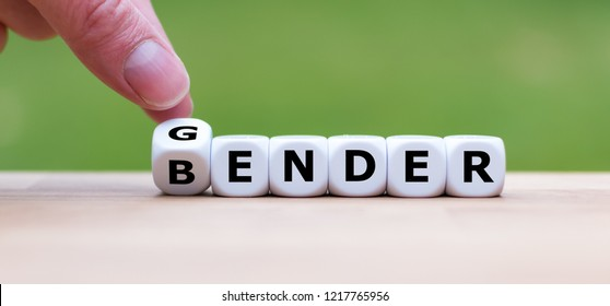 Hand is turning a dice and changes the word gender to bender