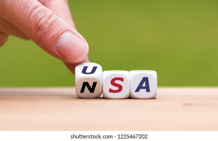 """Hand is turning a dice and changes the word """"NSA"""" to """"USA"""""""