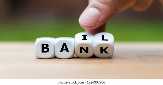 "Hand is turning a dice and changes the word ""Bank"" to ""Bail"""