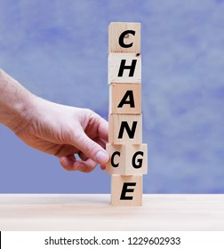 """Hand is turning a dice and changes the word """"Change"""" to """"Chance"""""""
