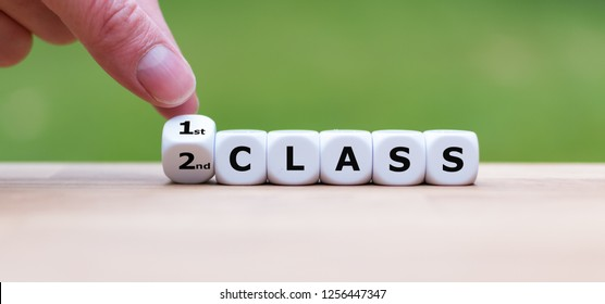 """Hand is turning a dice and changes the word """"2nd Class"""" to """"1st Class"""""""