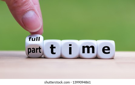 """Hand is turning a dice and changes the word """"full-time"""" to """"part-time"""" (or vice versa)."""