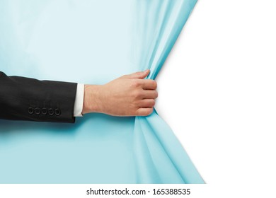 hand turns blue paper on white background