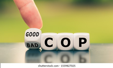 "Hand turns a dice and changes the expression ""bad cop"" to ""good cop"", or vice versa."