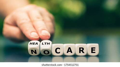 """Hand turns dice and changes the expression """"no care"""" to """"health care""""."""