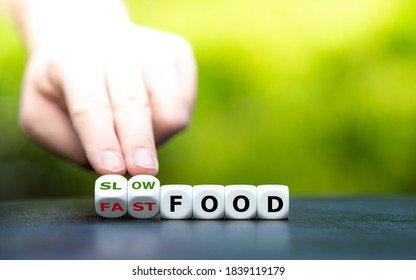 """Hand turns dice and changes the expression """"fast food"""" to """"slow food""""."""