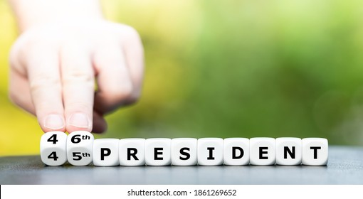 """Hand turns dice and changes the expression """"45th president"""" to """"46th president""""."""