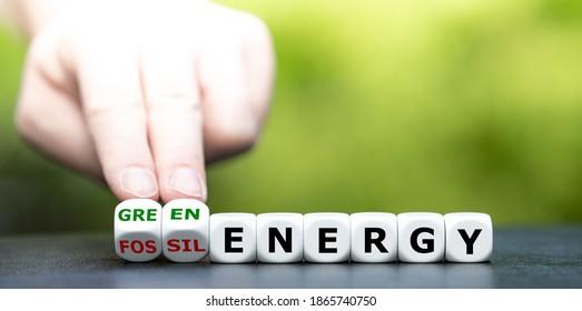 """Würfel und verwandelt den Begriff """"fossile Energie""""in """"grüne Energie""""."""