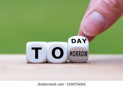 "Hand turns a dice and changes the word ""tomorrow"" to ""today"", or vice versa."