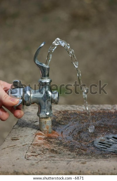 hand twisting tap on outside drinking fountain