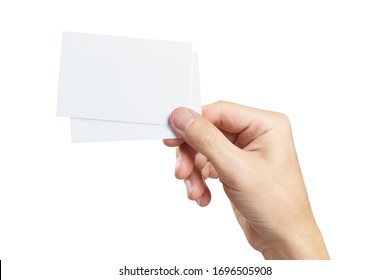 Hand with two pieces of paper or plastic (cards, tickets, flyers, invitations, coupons, banknotes, etc.), isolated on white background