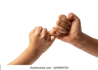 Hand of two young boy making a pinky promise isolated on white background. Promises to do business together.