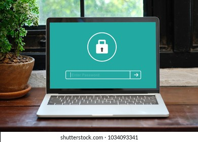 Hand tying laptop computer with password login on screen, cyber security concept