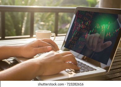 Hand typing a computer laptop trade stock and investor advice buy stock with green point color on screen