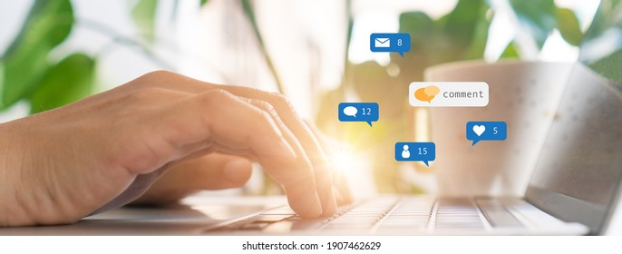Hand typing keyboard with laptop computer with social media and Marketing virtual icons screen concept.